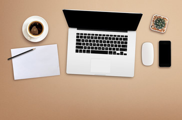 workplace with blank screen smartphone, tablet, coffee cup, paper and notebook on wooden table. top view with copy space. over light