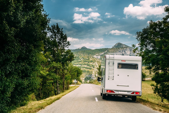 Motorhome Car Goes On Road On Background Of French Mountain Nature Landscape