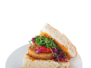 vegan bread with breaded spiced tofu, mashed eggplant and carrot spread and vegetables