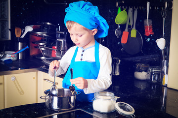 little boy enjoy cooking in kitchen