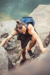 Climber man on high hill