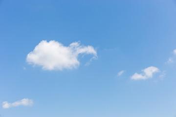 little cloud in blue sky