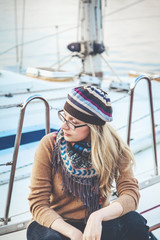 Attractive girl sitting on board