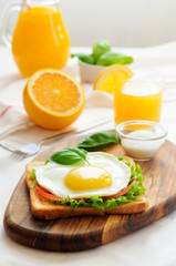 Toast with fried egg and vegetables