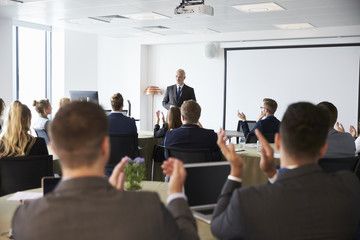 Mature Businessman Making Presentation At Conference