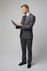 Studio Portrait Of Accountant Using Calculator