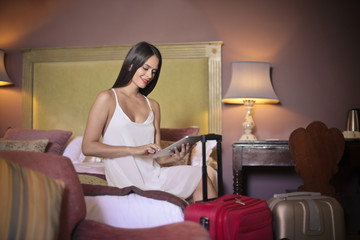 Beautiful woman sitting in a hotel bedroom