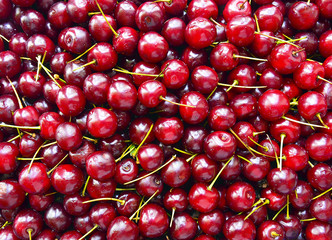 Fresh ripe organic cherry.Red sweet cherry background.Selective focus.