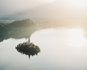 Island reflected in water, aerial view