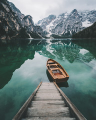 Mountain reflected in water with boat and stairway