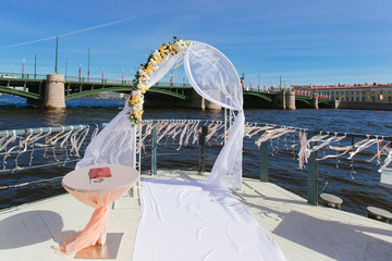 Stage wedding ceremony overlooking the river Neva