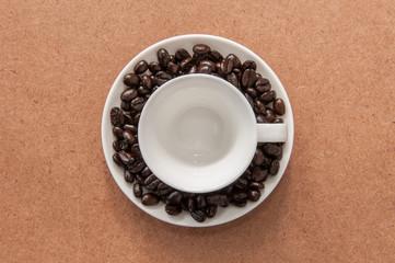 Coffee mug on coffee beans.