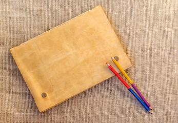 Sampling of stationery -  folder and pencils