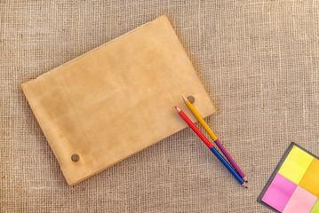 Sampling of stationery - notebook, folder and pencils