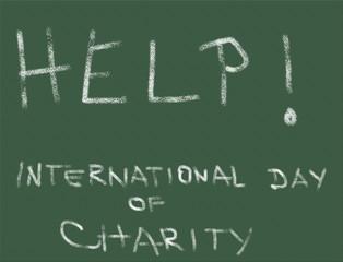 Word Help, International Day of Charity, written on a blackboard with chalk