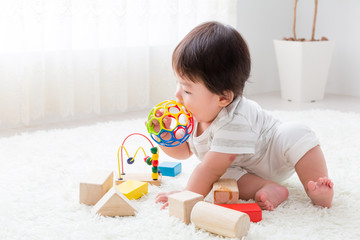 portrait of asian baby playing