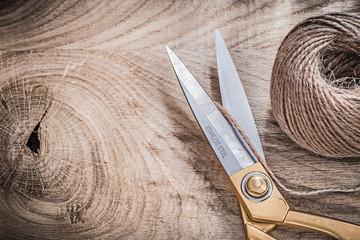 Vintage golden scissors hank of string on wooden board copy spac