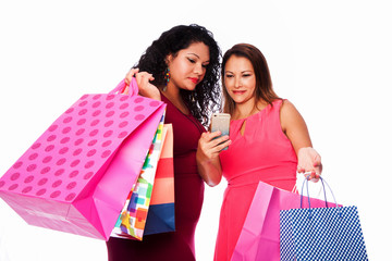 Happy women with shopping bags looking at phone