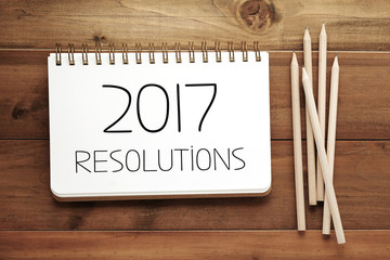 2017 resolutions on blank paper note book background