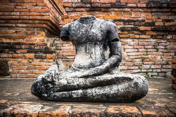 Old buddha statue and pagoda at Wat Chaiwatthanaram in the Ayutthaya Historical Park, Ayutthaya, Thailand.