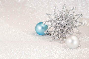 Christmas  decoration on glitter silver background