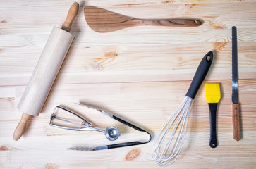 Top view of kitchen utensils on wood background