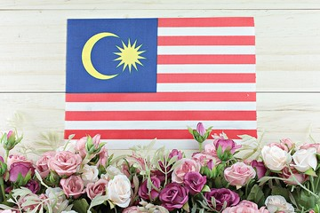 National day : Malaysia flag and flower on wood background
