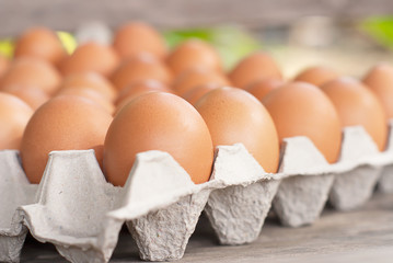 Picking Egg from The Carton of Eggs