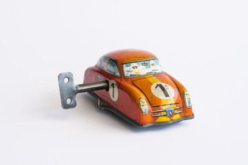 Clockwork toy car on white background