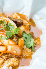 barbecued red pork and crispy pork in sauce with rice, thai styl