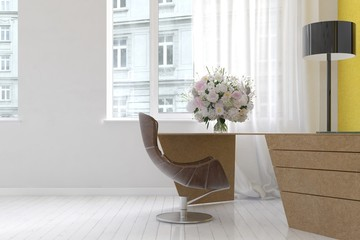 Horn shaped office chair at desk with bouquet