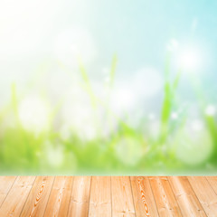 Wood plank on natural green grass field,Spring or summer abstrac
