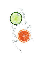 slice of grapefruit and lime in water