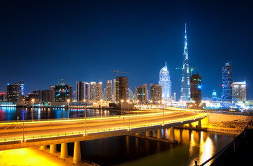 Fascinating reflection of tallest skyscrapers in Business Bay district during calm night with amazing bridge. Downtown summer day. , Downtown, Dubai, United Arab Emirates.