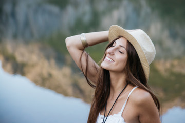 Side view of smiling beautiful women in hat and skirt with eyes closed