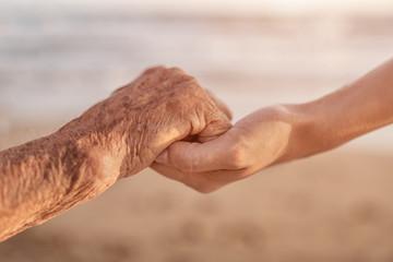 Woman Holding Senior Woman hand
