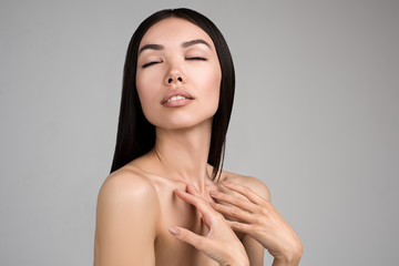 Beautiful Woman With Perfect Skin and Long Hair Beauty Studio Portrait