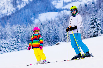 Kids skiing in the mountains