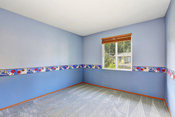 Empty colorful boy's room with carpet floor