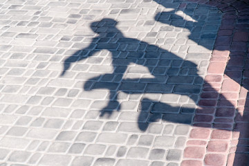 Shadow jumping man