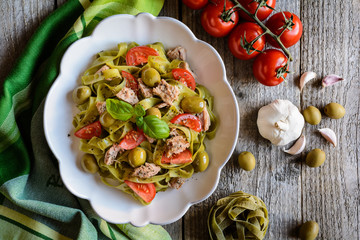 Tagliatelle pasta with tuna fish, tomato and olives