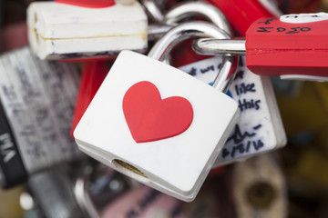 SEOUL, SOUTH KOREA - AUGUST 09, 2016: Close up of several locks on fence near Namsan Tower as a sign of mutual love. Seoul, South Korea on August 09, 2016