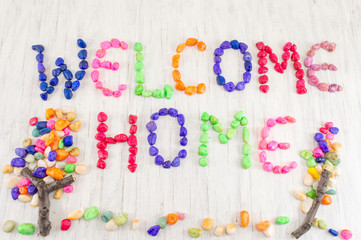Welcome home note written with small rocks