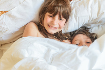 young children - boy and girls - sleeping in bed at home, indoor