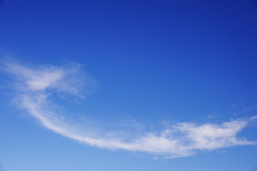white cloud in winding shape on the blue sky