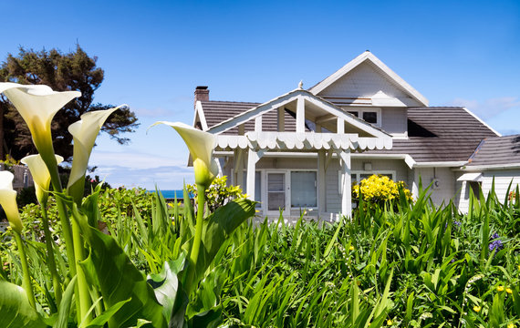 Flower garden frames a view of classic vintage beach architecture