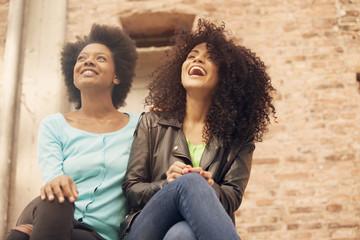 Happy african american girls having fun outdoors