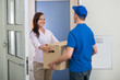 Delivery Man Gives Package To Woman