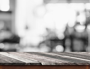 Empty grunge diagonal wood table top with black and white people
