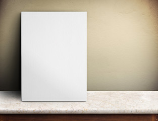 Blank White paper poster on marble table at yellow concrete wall